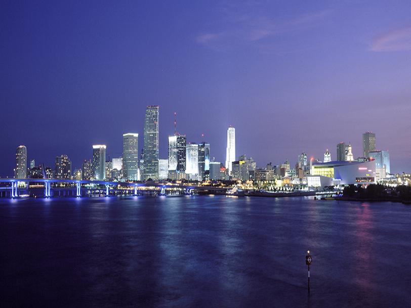 Miami real estate - Miami at night - skyline view of the beautiful city, as seen from Miami Beach